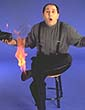 San Francisco based magician, Paul Nathan whith his foot on fire